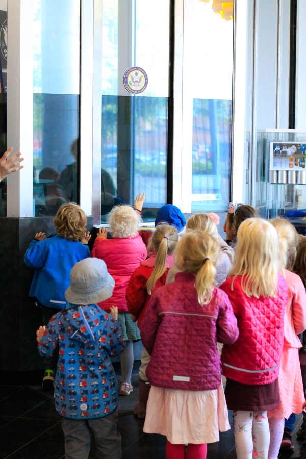 A group of forest school toddlers visit the American Embassy in Copenhagen, Denmark to learn about diplomats and diplomacy.